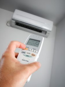 closeup view about using some appliance such as air conditioner