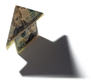 money folded origami style to look like a house