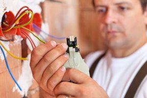 electrician working on rewiring