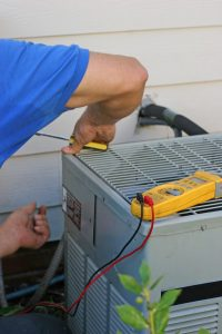 technician-working-on-ac-outdoor-unit