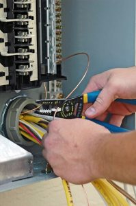 electricians-hands-fixing-electrical-panel