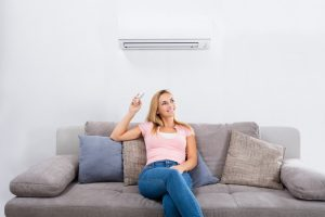 woman-with-ductless-air-handler